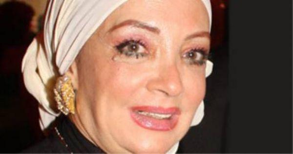 بالصور الفنانة شهيرة في غاية الاناقة مع زوجها محمود يس وتخرج خصلة شعرها من الحجاب